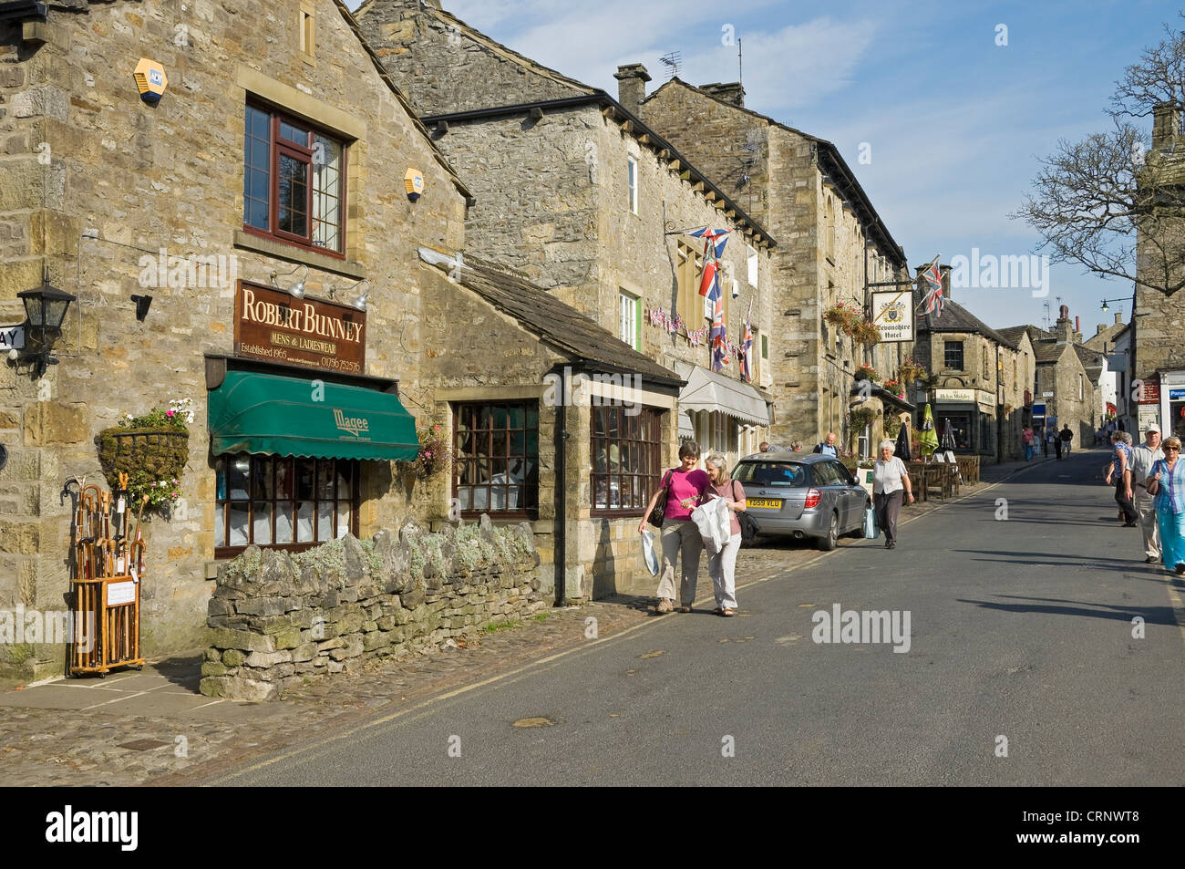 People walking through the small market town of Grassington, the main tourist centre in Upper Wharfedale. Stock Photo