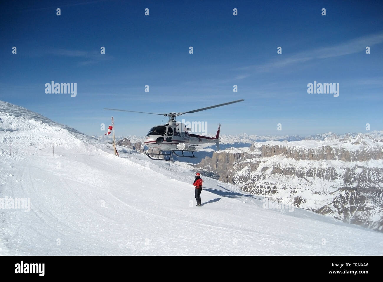 A helicopter landing on a mountain - Stock Image