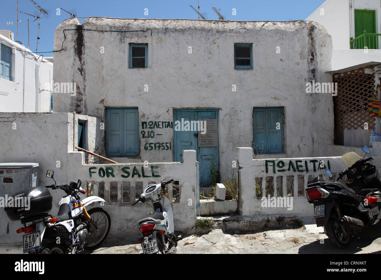 Derelict house for sale, Mykonos, Greece Stock Photo