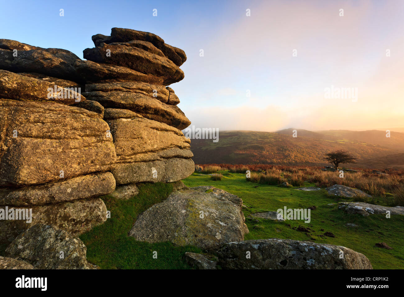 Early morning light on the granite outcrop of Combestone Tor in the Dartmoor National Park. - Stock Image