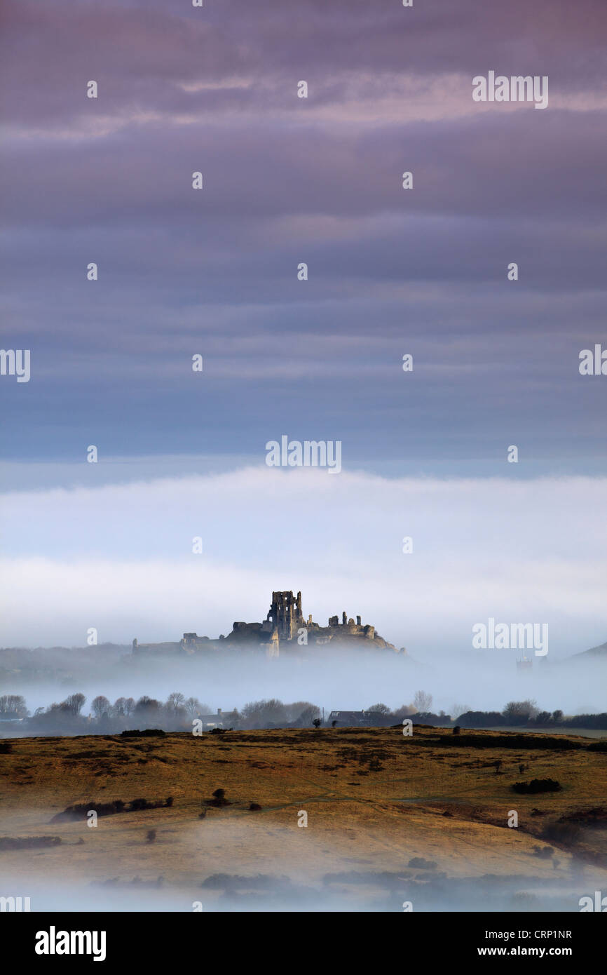Mist around Corfe Castle viewed from Kingston on a winter morning. - Stock Image