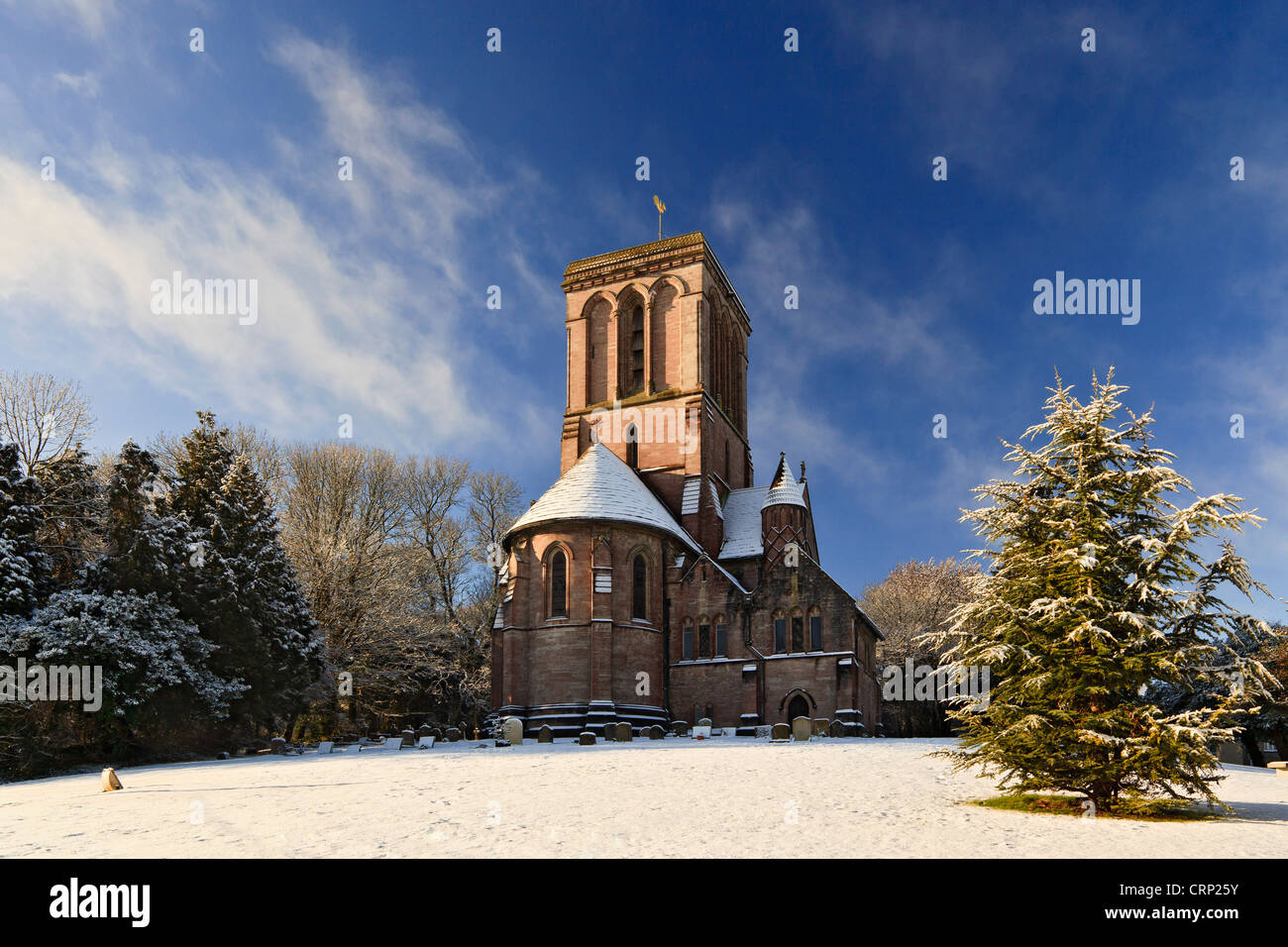 Snow covering the grounds of the Church of St. James at Kingston, on the Isle of Purbeck. - Stock Image