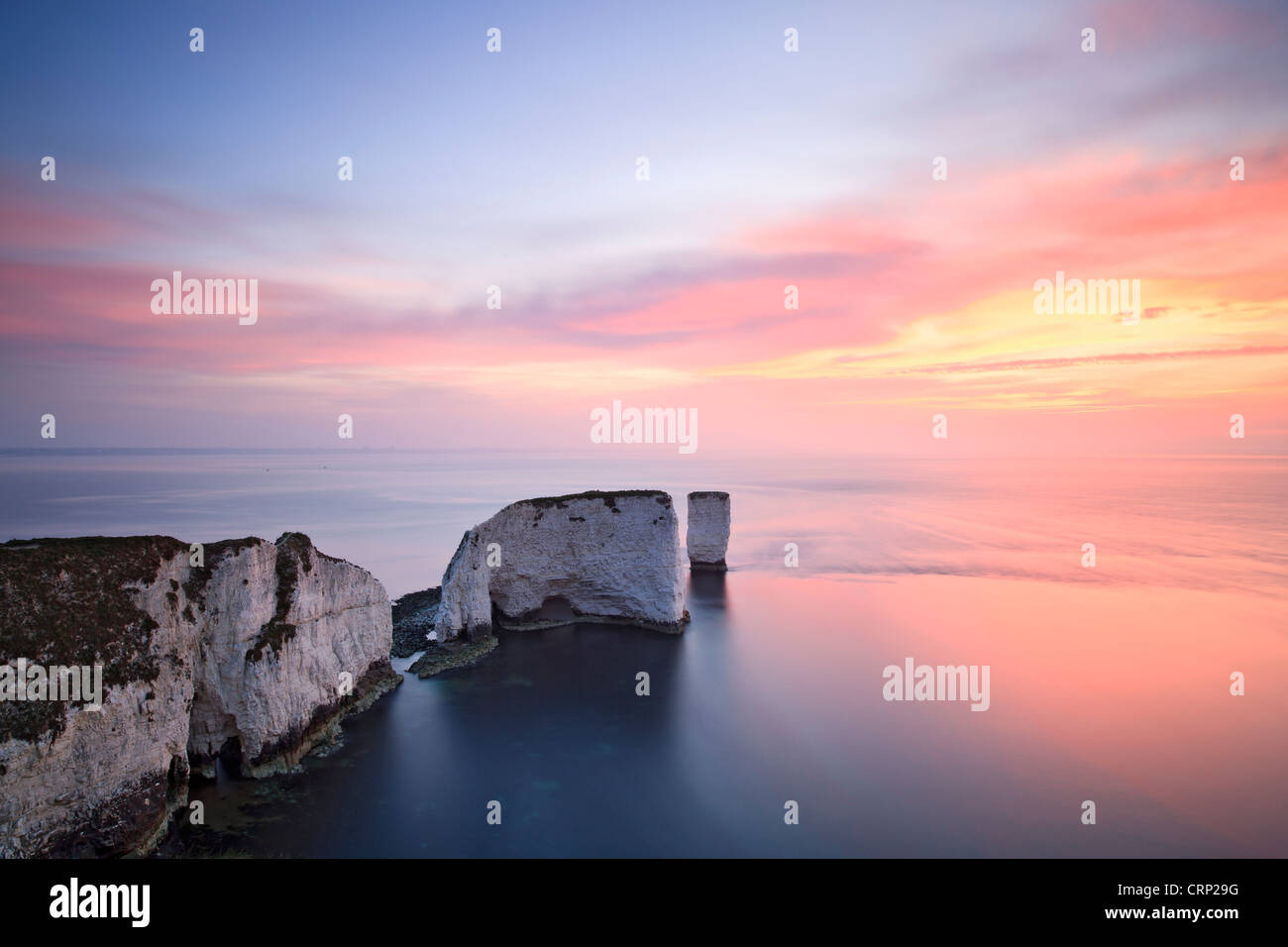 Sunrise at Old Harry Rocks on Dorset's Jurassic Coast world heritage site near Swanage. Stock Photo