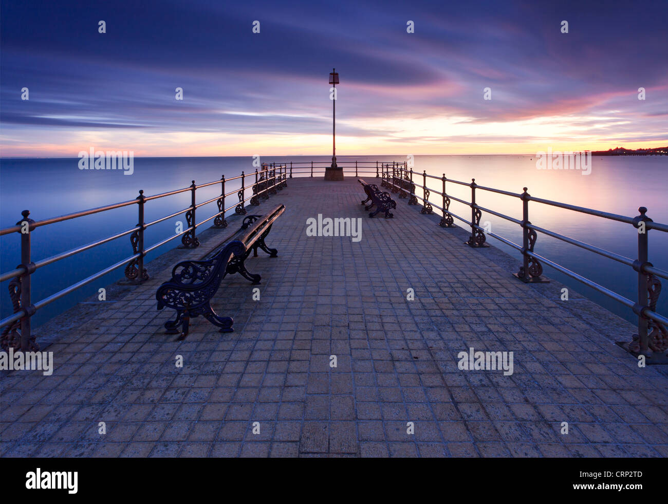 Sunrise over the Banjo shaped Jetty in Swanage Bay. - Stock Image