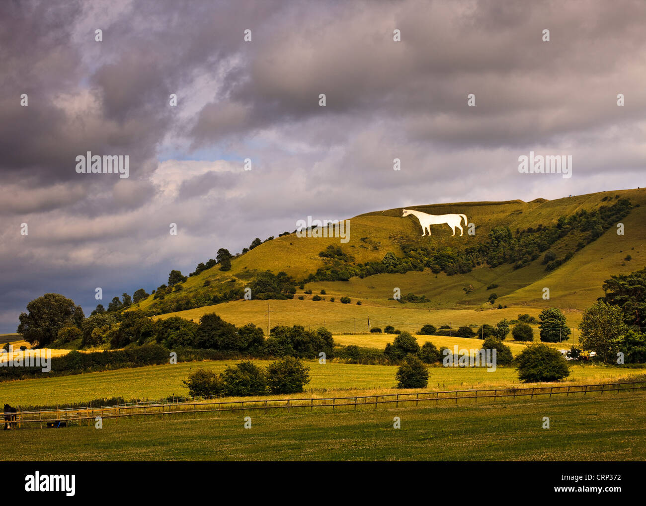 Stormy sky over the Westbury white horse, the oldest of Wiltshire's white horses, on the edge of the Bratton Downs. Stock Photo