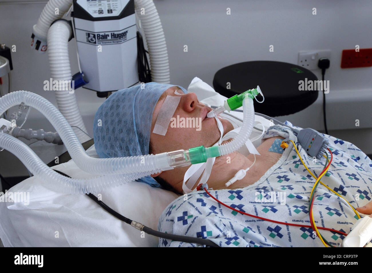 An anesthetized patient before undergoing surgery. - Stock Image