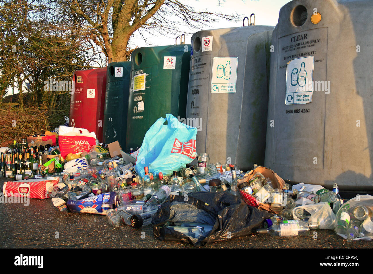 Bottlebanks for glass recycling, overflowing after Christmas, Bacton, Suffolk, England, january - Stock Image