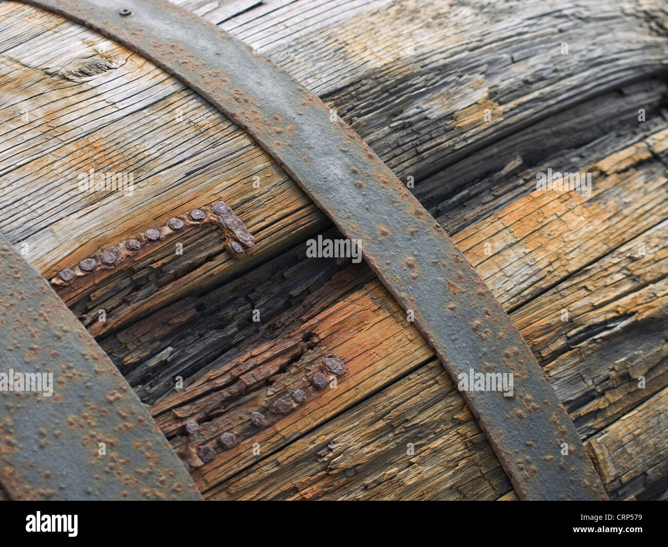 Rusty wine barrel, close up of weathered wood  and rusty iron bands, Lanzarote, Canaty islands Spain - Stock Image