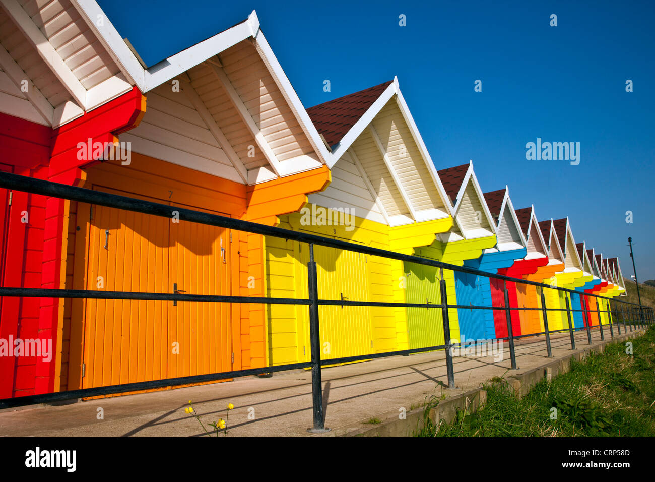Colourful beach huts in North Bay, Scarborough. - Stock Image