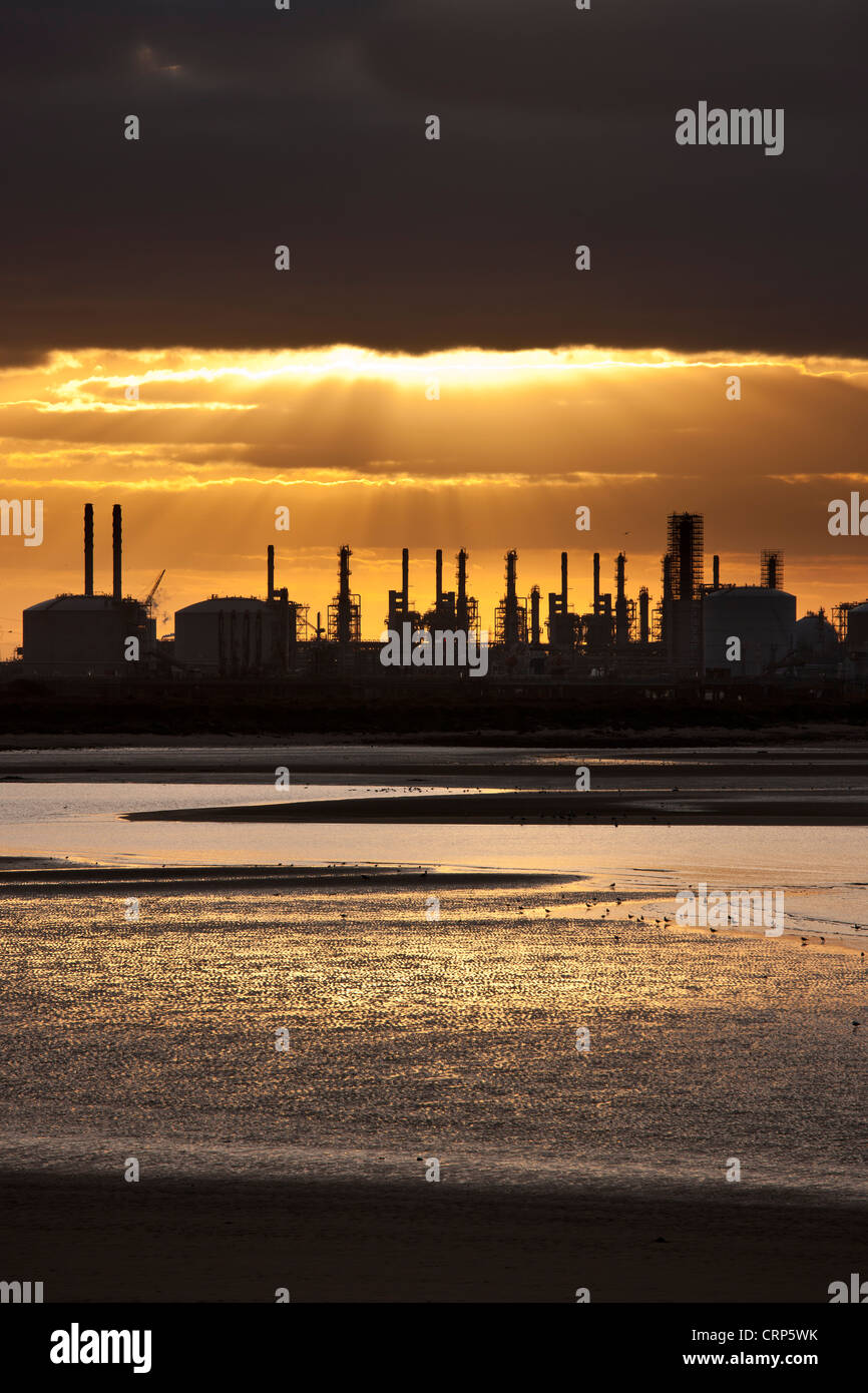 Sunset over an oil refinery at Teesmouth on the Tees estuary. - Stock Image