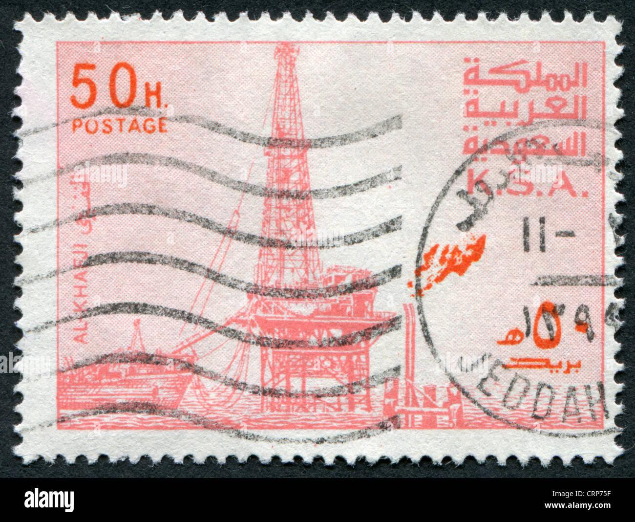 Postage stamps printed in The Kingdom of Saudi Arabia (KSA), shows the oil derrick in Al Khafji, circa 1977 - Stock Image
