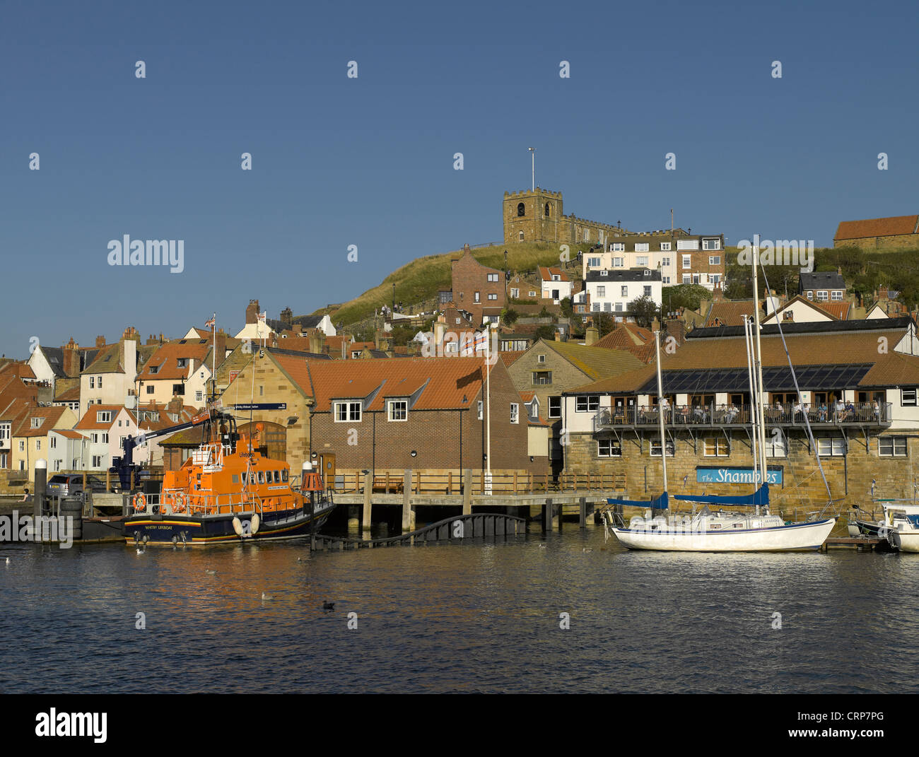 RNLI lifeboat George and Mary Webb moored below St Marys Church at Whitby Lifeboat Station. - Stock Image