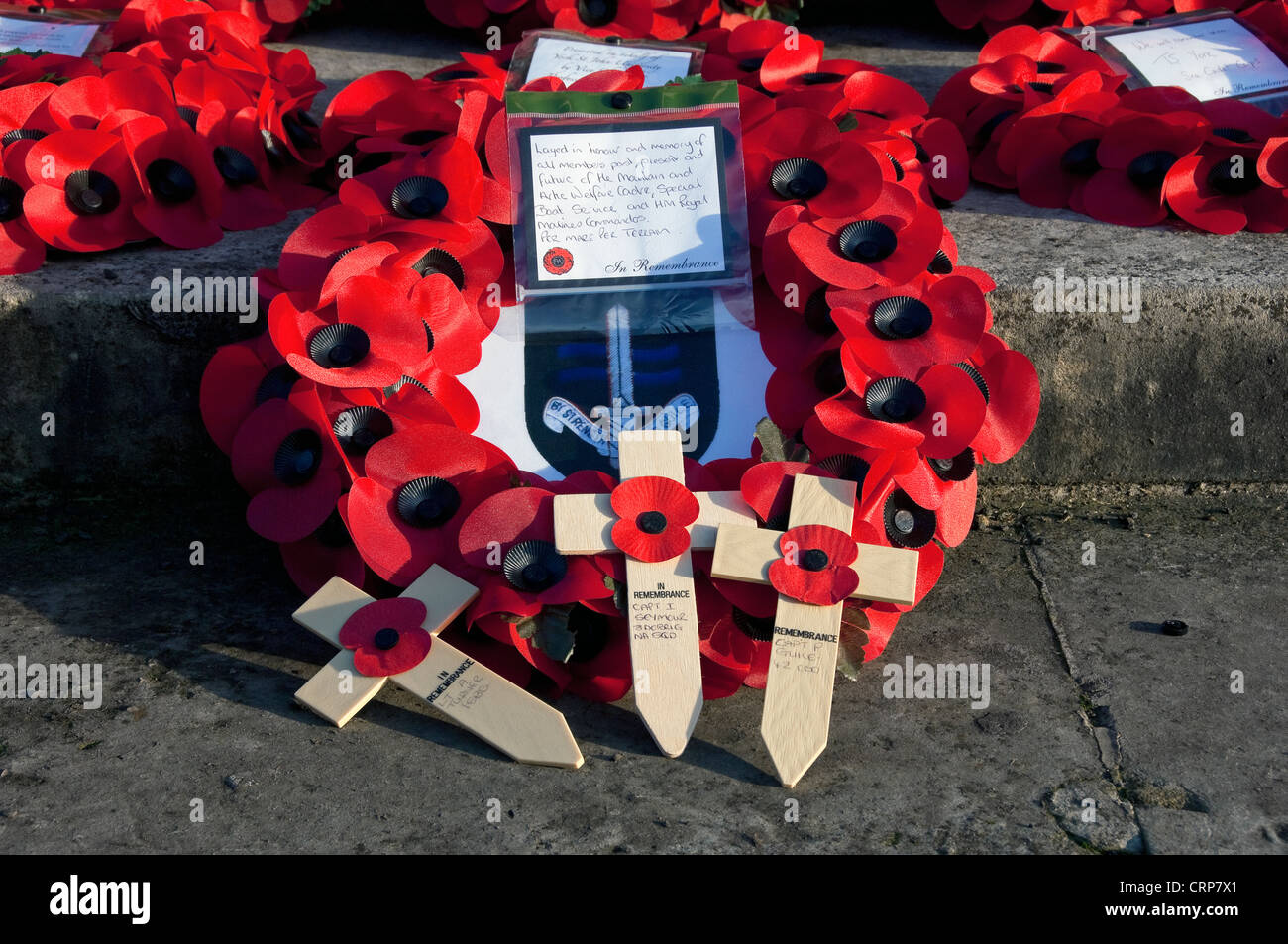 Poppy wreaths and crosses on the York City War Memorial in the Memorial Gardens. - Stock Image