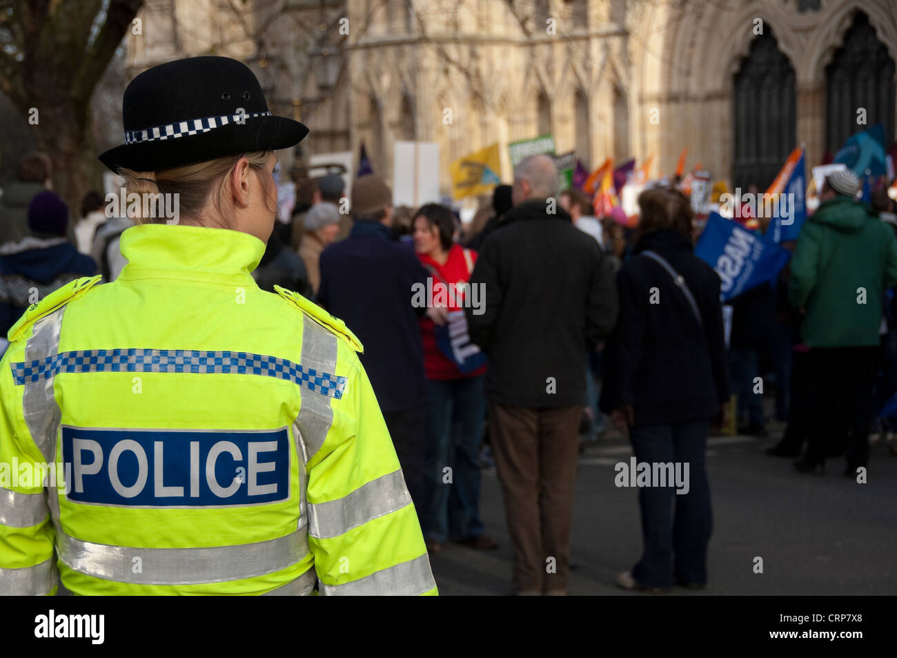 Police woman on duty at a protest by UNISON trade union members outside York Minster. - Stock Image