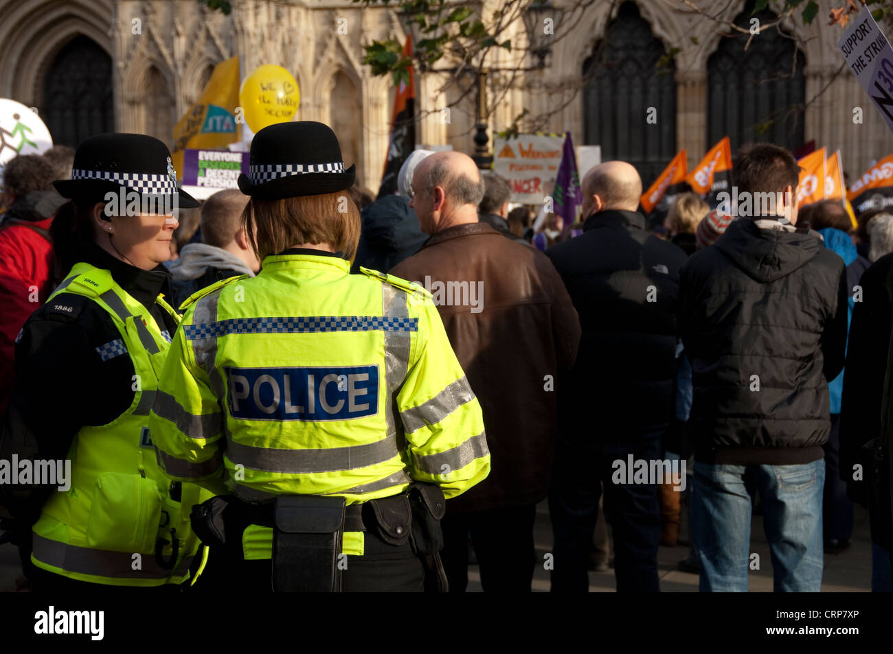 Police women on duty at a protest by UNISON trade union members outside York Minster. - Stock Image