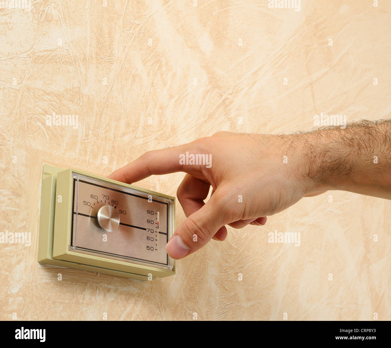 adjusting the room temperature - Stock Image