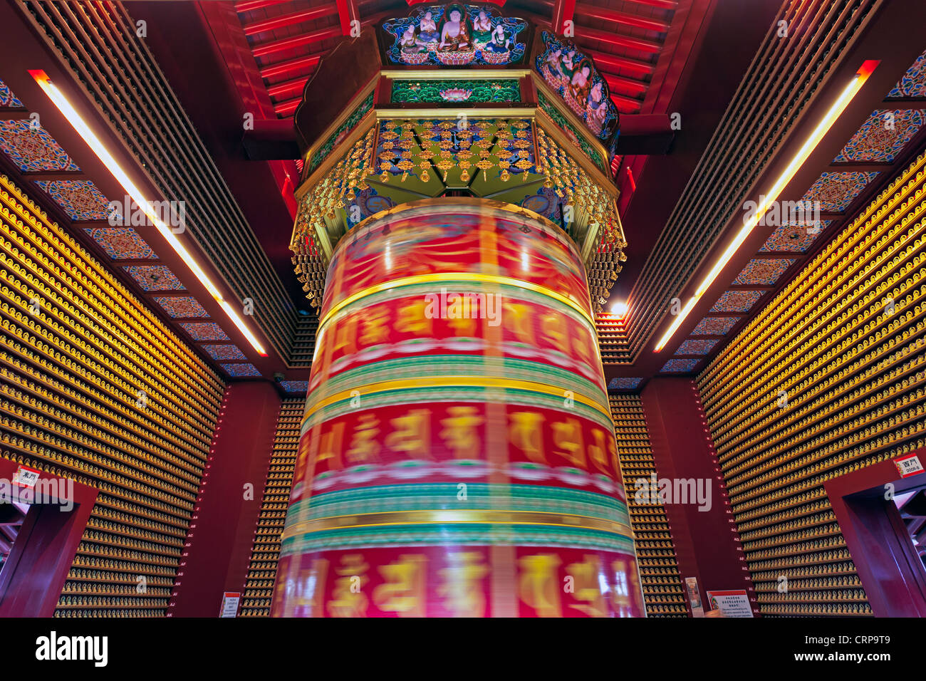 Prayer wheel inside the New Buddha Tooth Relic Temple and Museum on South Bridge road in Singapore, South East Asia - Stock Image