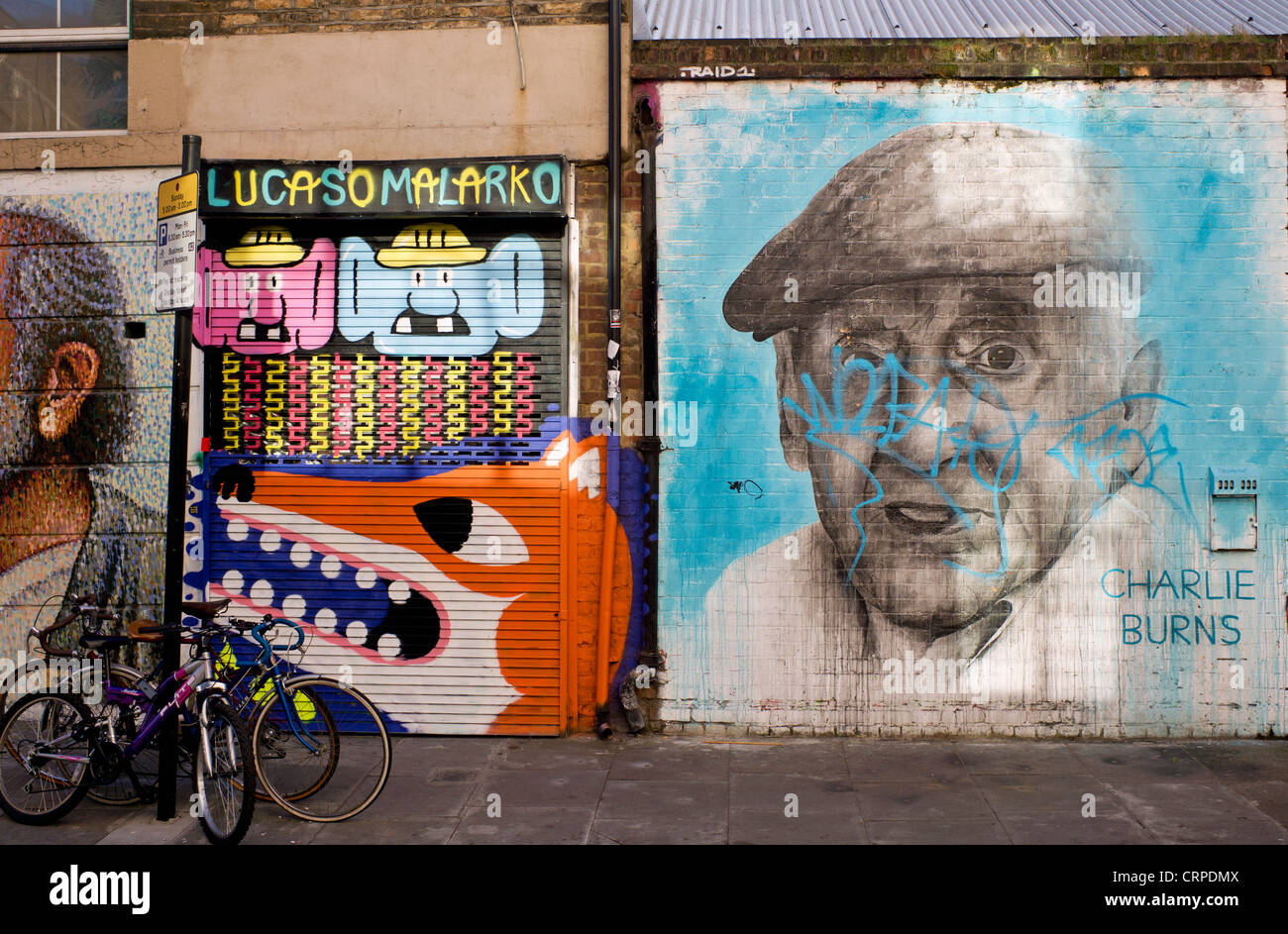 Street art in Bacon Street in the East End of London. - Stock Image