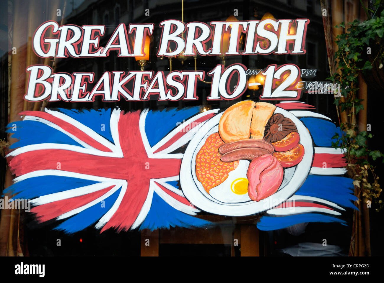 Sign in the window of a London pub advertising its offer of a Great British Breakfast between 10 and 12. Stock Photo
