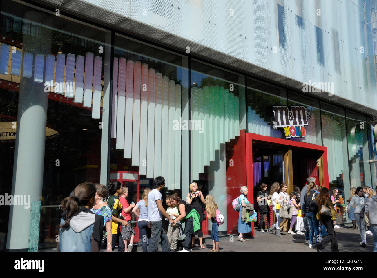 People outside M&M's World in Leicester Square. The shop is the largest candy store in the world. - Stock Image
