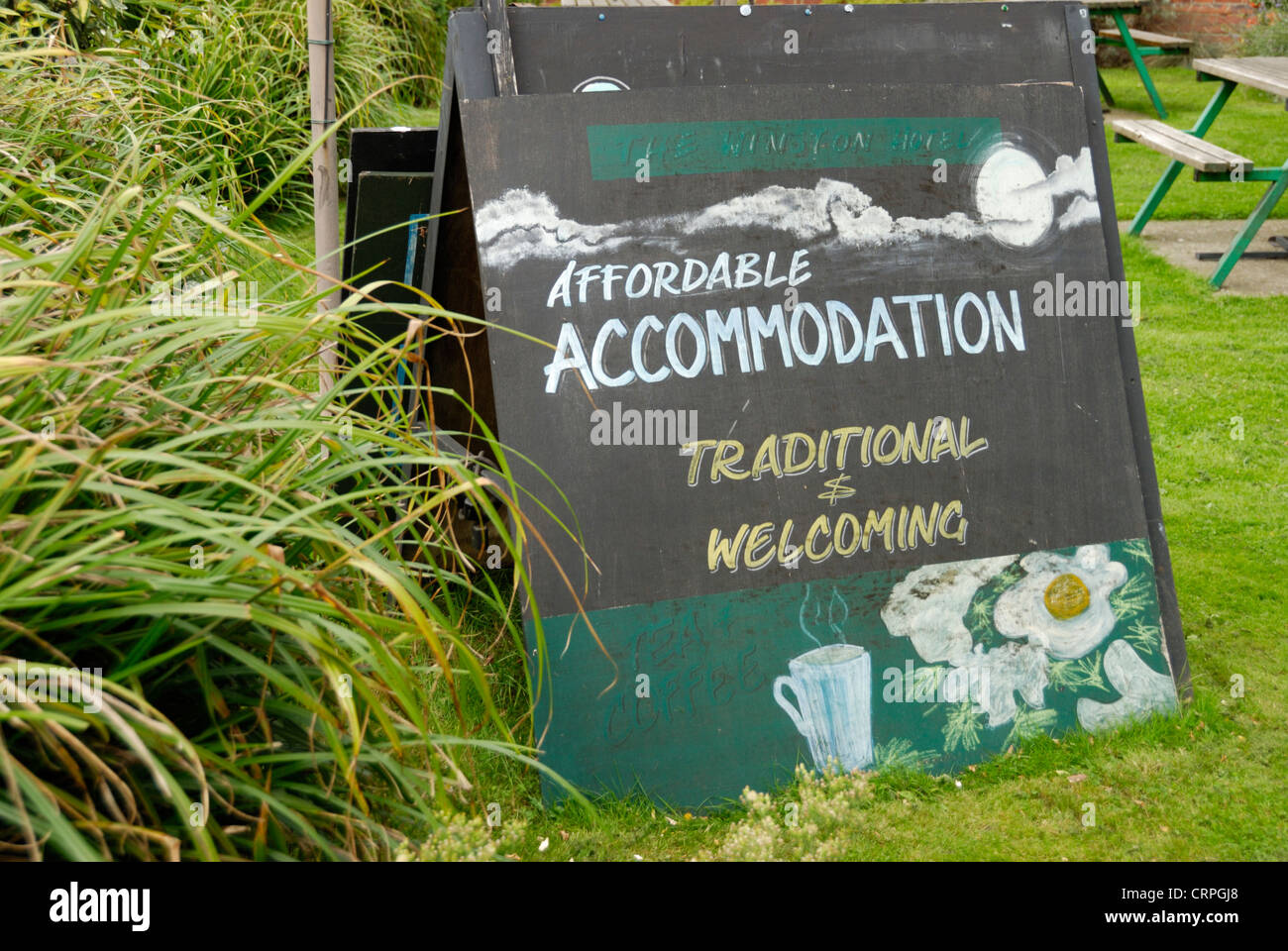 Sign outside The Winston Hotel advertising affordable accommodation. - Stock Image