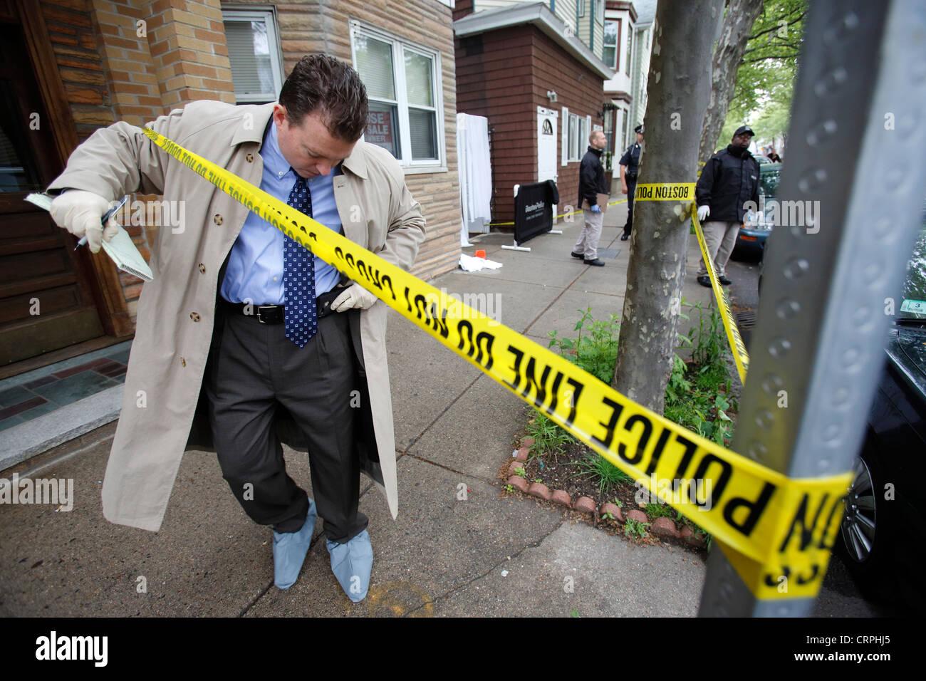 A police detective leaves a crime scene, Boston, Massachusetts - Stock Image