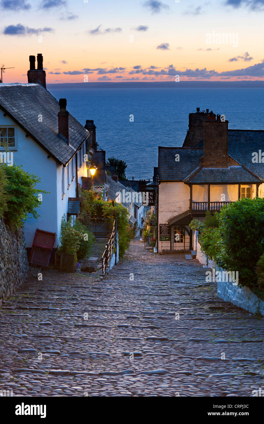 Steep narrow cobbled street leading down to the world famous fishing village of Clovelly. Stock Photo
