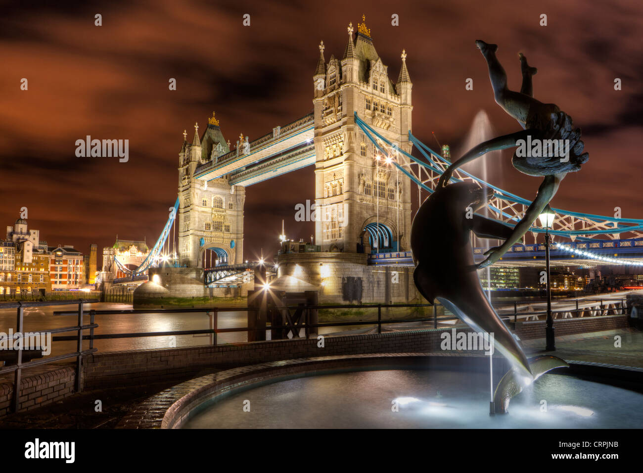David Wynne's 'Girl with a Dolphin' statue on the North bank of the River Thames by Tower Bridge. - Stock Image