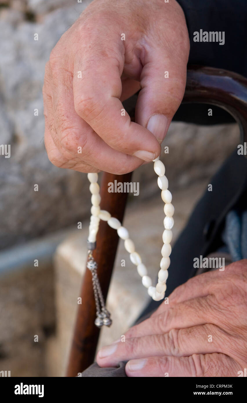 Arab man fingers Muslim prayer beads, Jerusalem, Israel - Stock Image