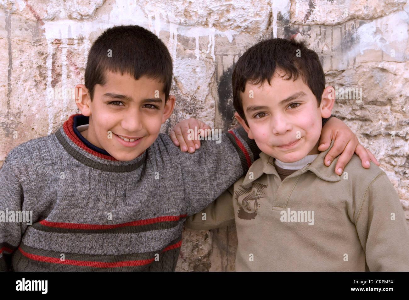 Arab boys in the Old City's Muslim Quarter, Jerusalem, Israel - Stock Image
