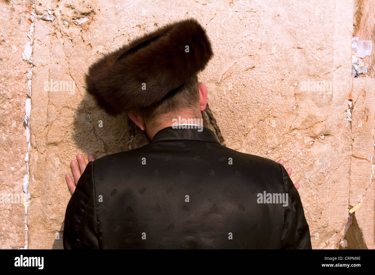Hassidic Jew worships at the Old City's Western Wall, Jerusalem, Israel - Stock Image