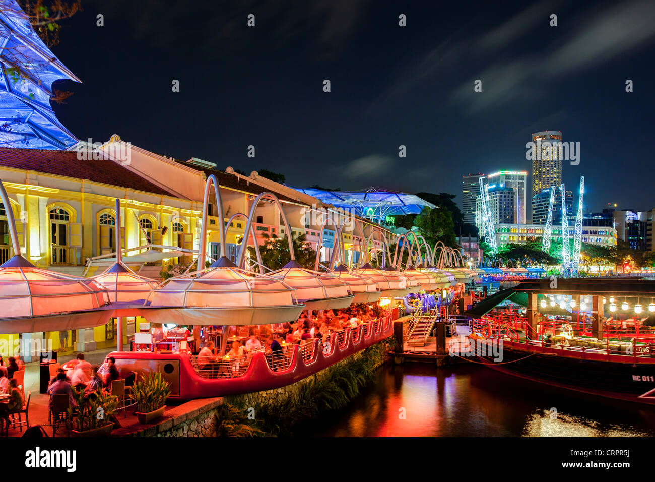 South East Asia, Singapore, The Entertainment district of Clarke Quay, the Singapore river and City Skyline - Stock Image