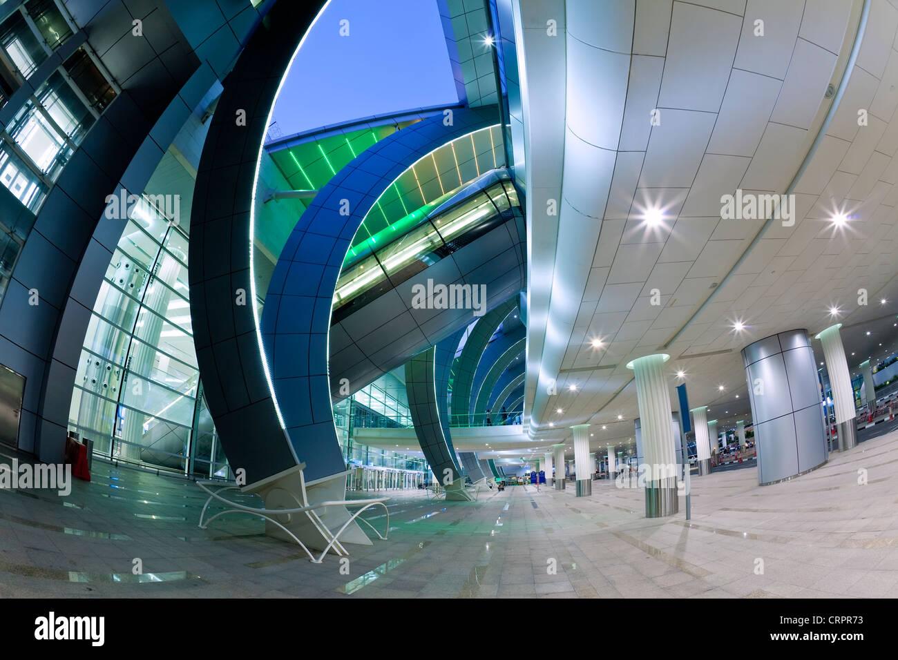 Stylish modern architecture of the 2010 opened Terminal 3 of Dubai International Airport, Dubai, UAE, United Arab - Stock Image
