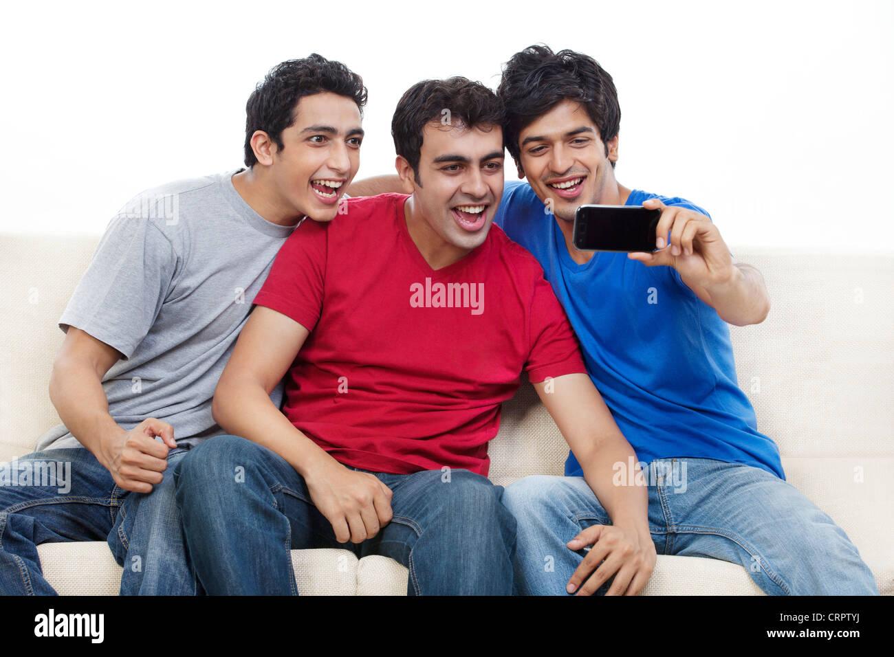 Three friends talking self portrait photograph - Stock Image