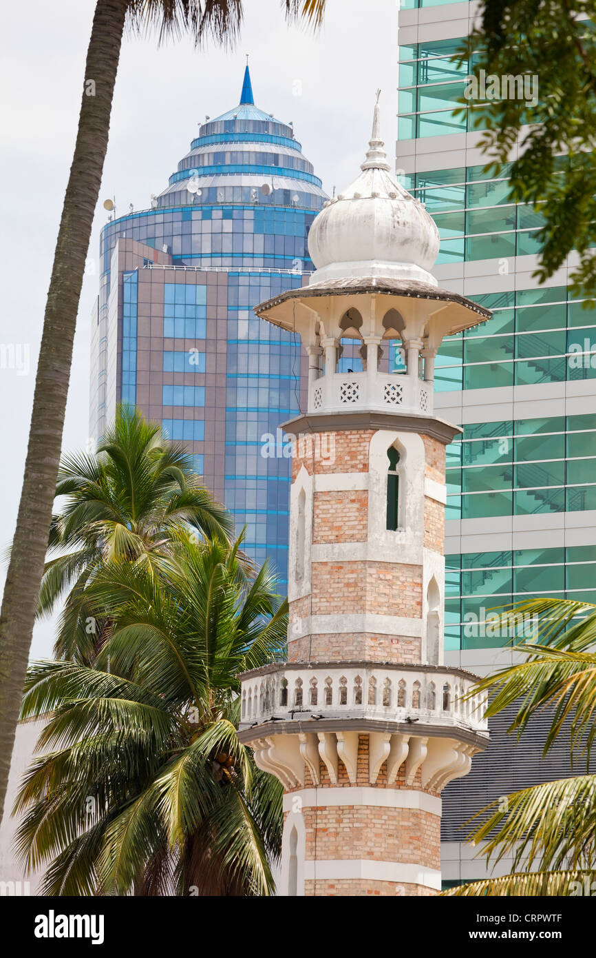 South East Asia, Malaysia, Kuala Lumpur, Masjid Jamek (Friday Mosque) and modern architecture - Stock Image