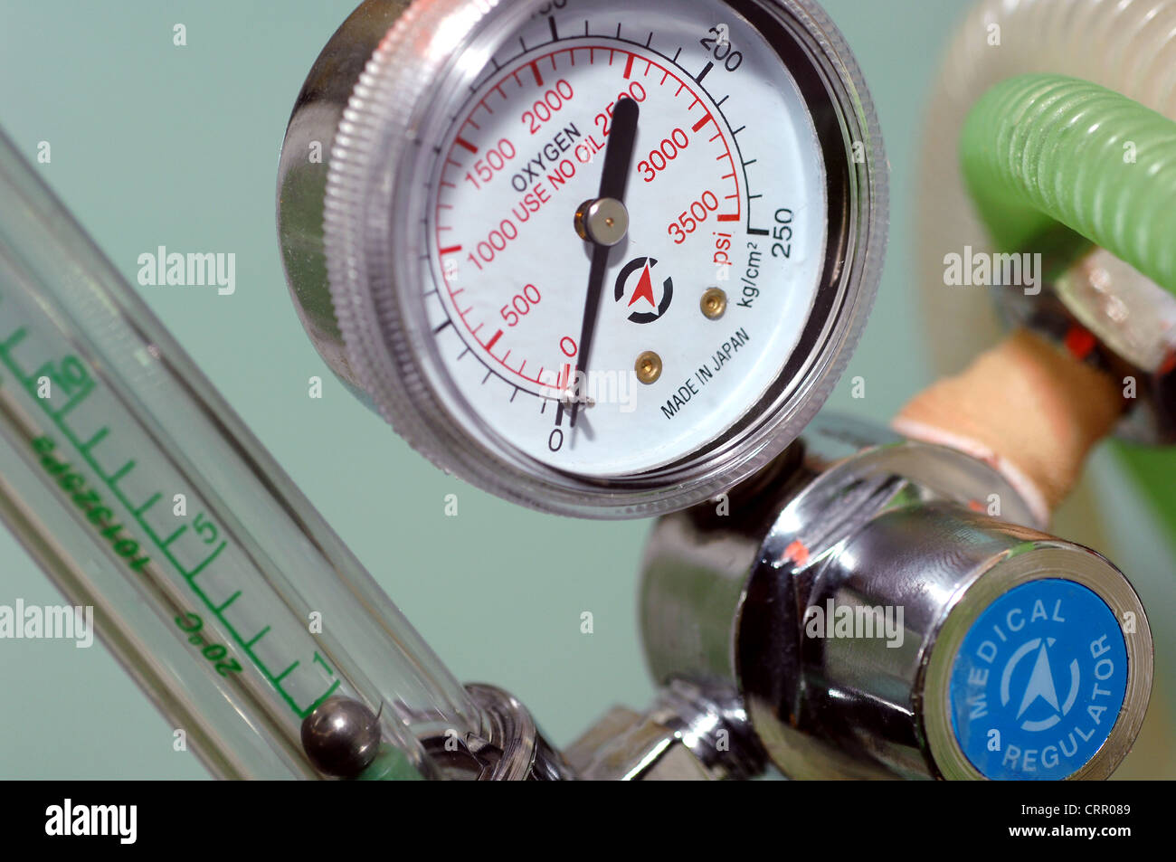 Close up of a pressure meters for oxygen tanks, attached to a regulator - Stock Image