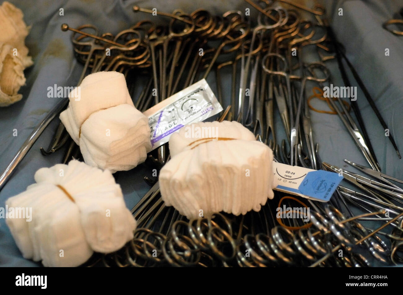 A mixed tray of surgical equipment including; forceps, swabs and scissors. - Stock Image
