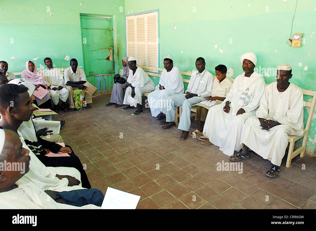 Patients wait to be called by their doctor, in a typical waiting room for outpatients in Soba, Sudan - Stock Image