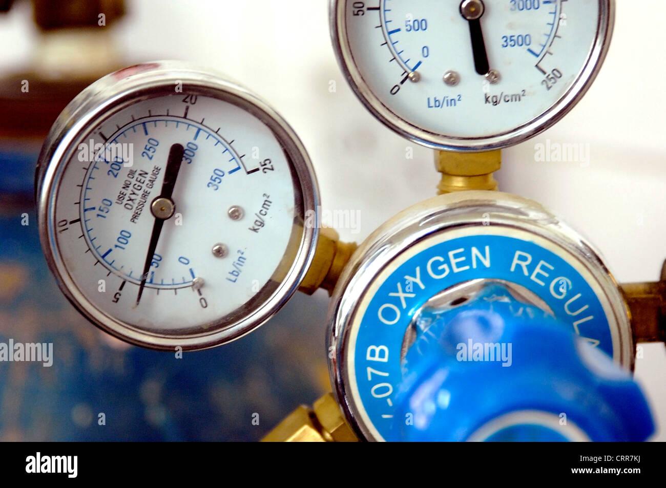 Oxygen regulator pressure gauge. - Stock Image