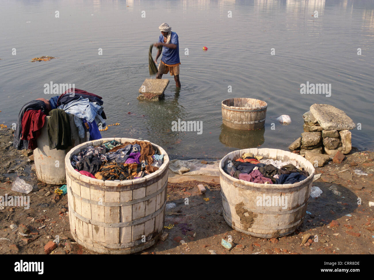 Man washing clothes in the Sabarmati river ( India) - Stock Image