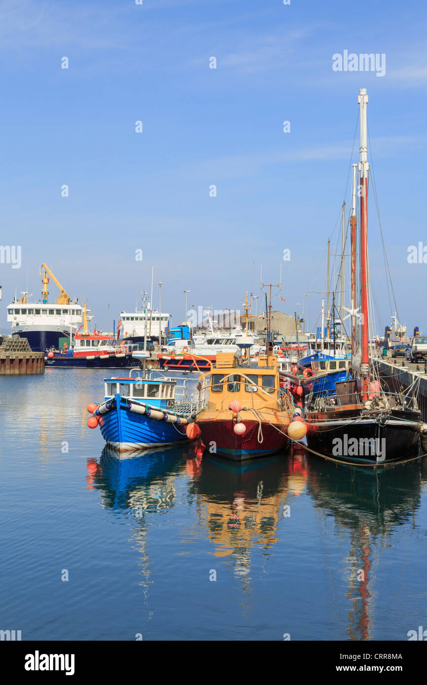 Fishing boats moored in the inner harbour with the ferry beyond in Kirkwall, Orkney Islands, Scotland, UK, Britain - Stock Image