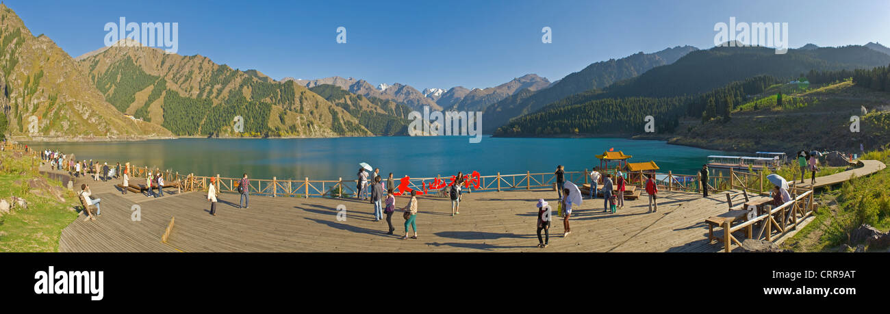 A 4 picture stitch panoramic of local tourists at the Chinese alpine beauty spot, Heavenly Lake. Stock Photo