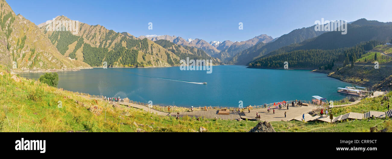 A 3 picture stitch panoramic of local tourists at the Chinese alpine beauty spot, Heavenly Lake. Stock Photo