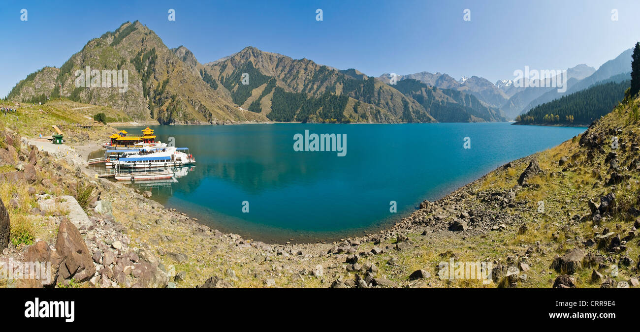 A 2 picture stitch panoramic of the Chinese alpine beauty spot, Heavenly Lake. Stock Photo