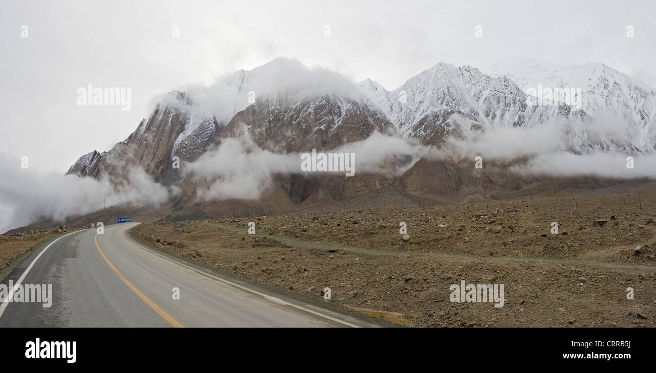 A 2 picture stitch panoramic view travelling along The Karakoram Highway that connects China and Pakistan. - Stock Image