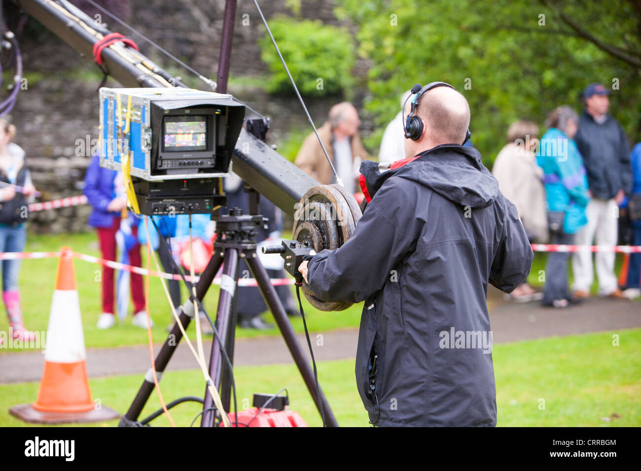 Filming the olympic torch relay through Ambleside, Lake District, UK. Stock Photo