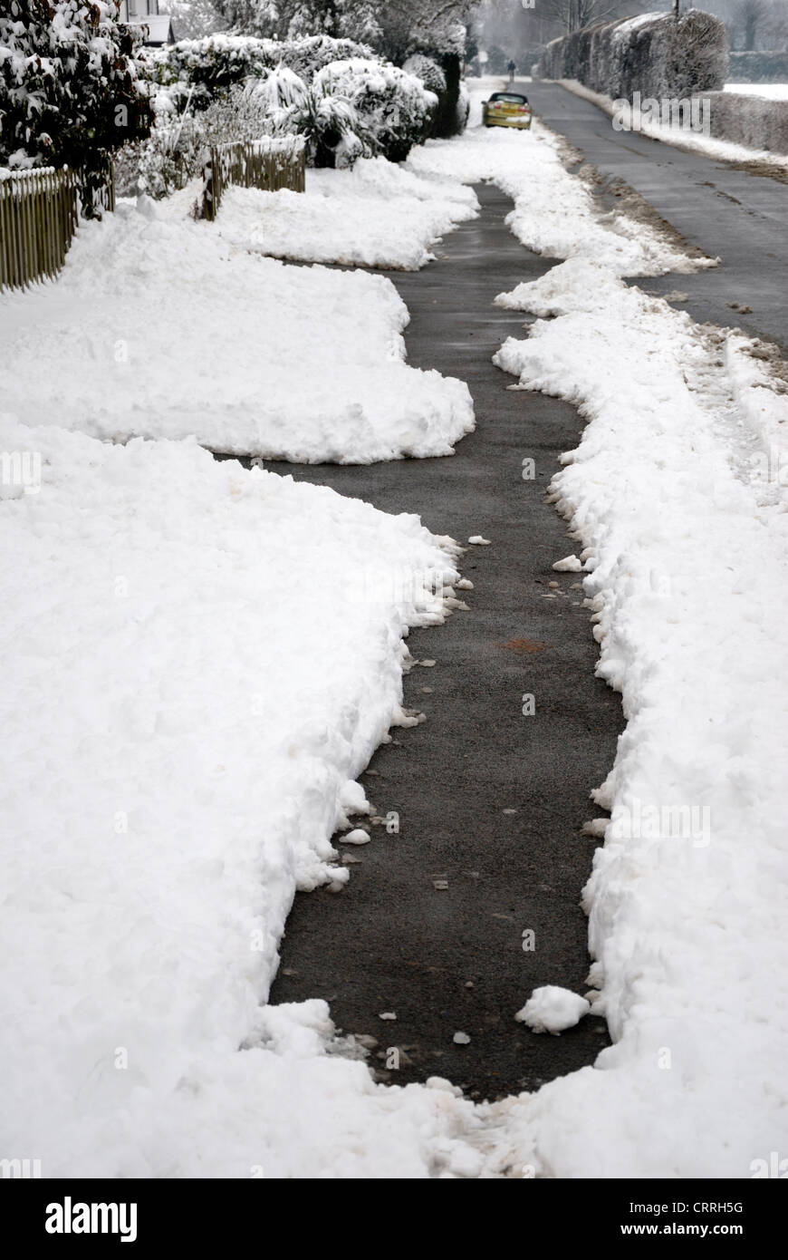 Footpath cleared of snow - Kent, England - Stock Image