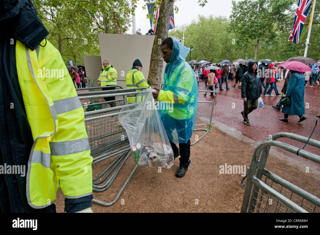 Team of men collecting litter after Diamond Jubilee event Stock Photo
