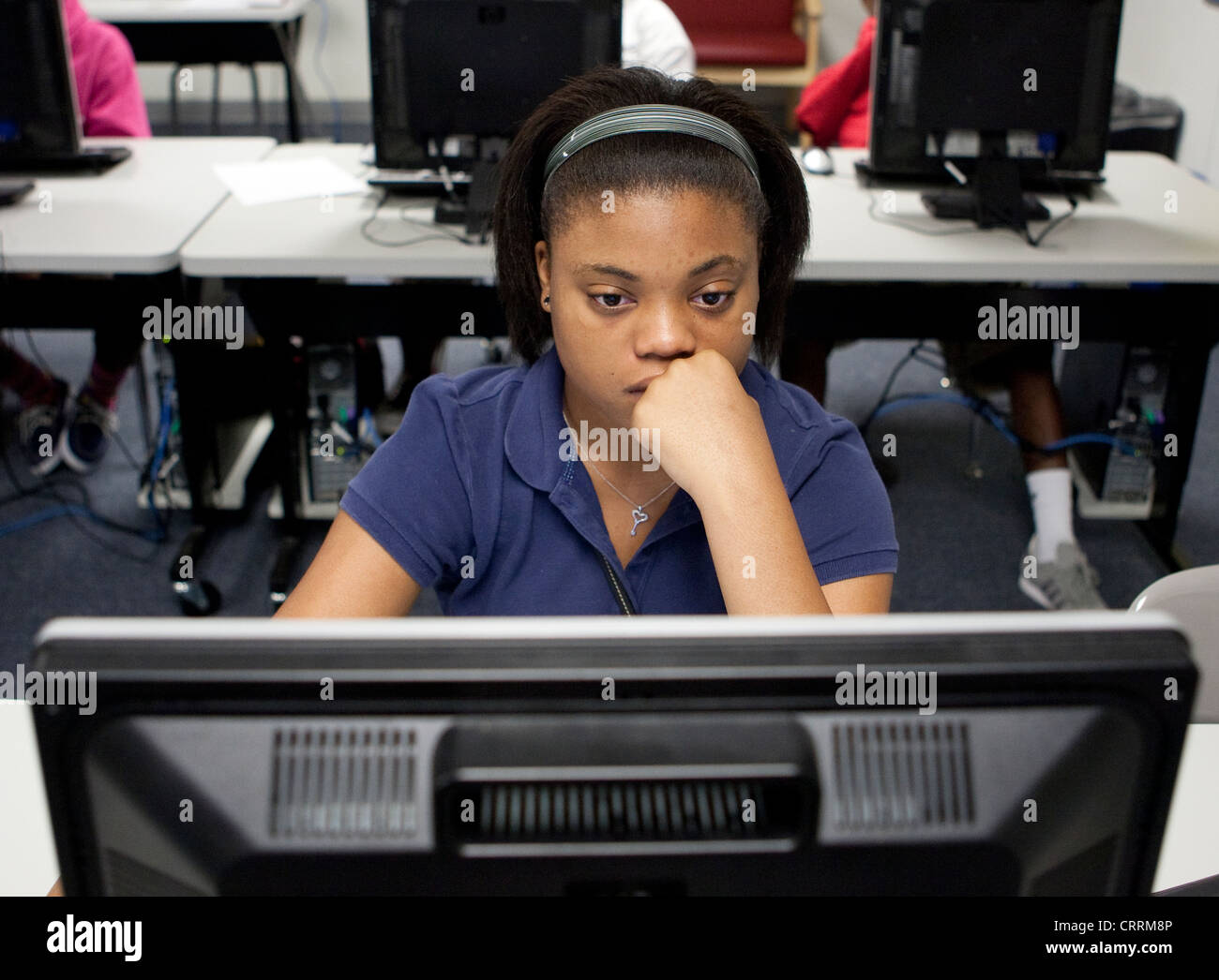 African-American student in computer lab at a public charter high school in Houston, Texas - Stock Image
