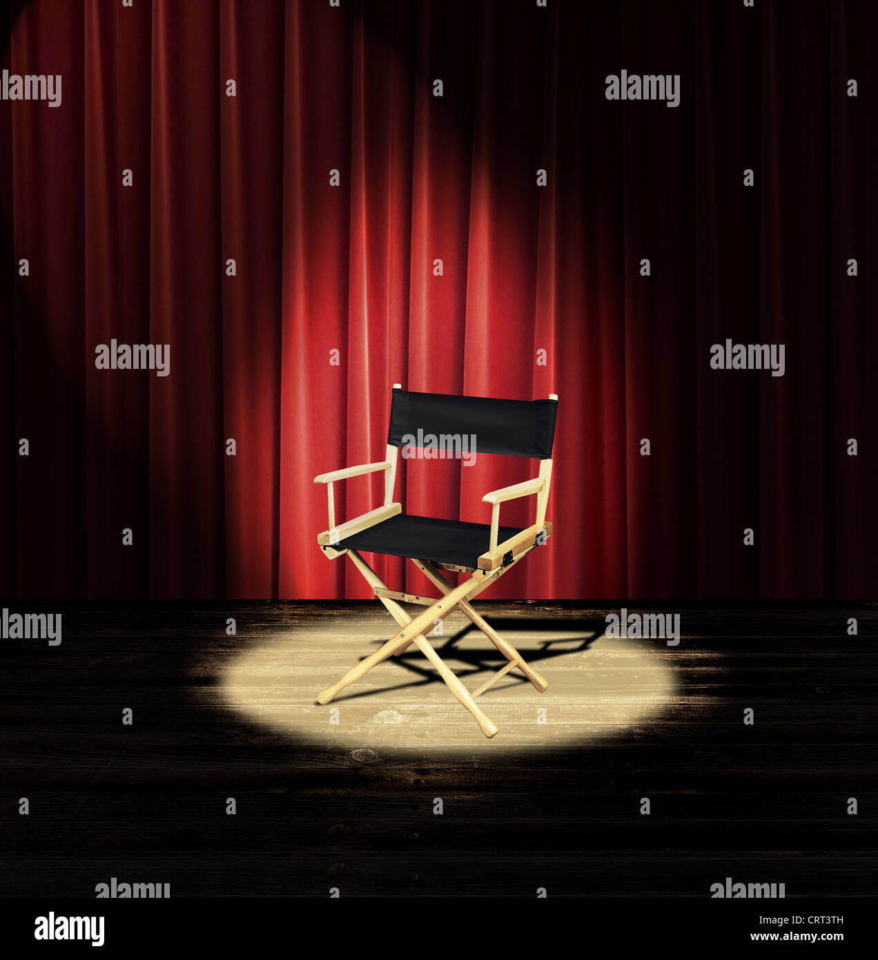 A Directors Chair On Stage With Red Curtain And Spotlight